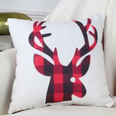 A red and brown plaid reindeer pillow adds a fun touch to any rustic room, especially in the winter during the Christmas season!