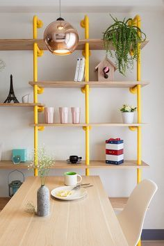 Industrial pipe shelving in a sunny, yellow hue