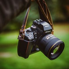 Two of the finest products Nikon has ever made: the and Attached to one of the finest products we've ever made: brown Westminster strap. Cameras Nikon, Nikon Digital Camera, Digital Cameras, Leica Camera, Nikon Dslr, Canon Lens, Digital Slr, Camera Wrist Strap, Leather Camera Strap