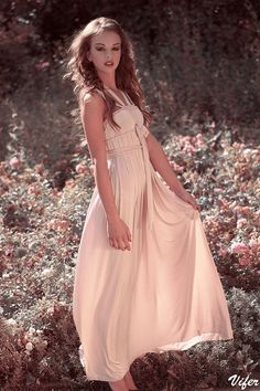 This prettily-detailed gown would be a charming choice for a summer wedding.