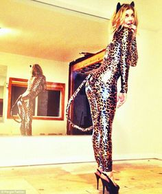 2570f933 Fergie as a 'naughty kitty' posing in her skin-tight racy leopard Halloween