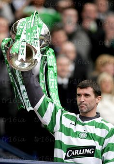 March 19 2006, Hampden Park, Glasgow.  CIS Cup Final, Celtic v Dunfermline (3-0).  Roy Keane  gets his hands on the trophy after leaving the field injured in the second half.  Click through for full size.