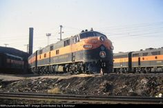 Great Northern E units and F units at the St Paul MN roundhouse depot in The GN kept all of their passenger units in back of the St Paul depot roundhouse. Back Of America, Great Northern Railroad, Burlington Northern, Covered Wagon, Train Pictures, Round House, The St, Trains, Westerns