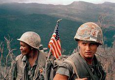 December 1969: Marines move through a landing zone. AP Photo - Vietnam War