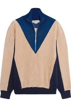 Beige fleece, navy jersey and blue mesh Zip fastening along front Fabric1: 63%…