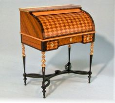 At The Good Sam Showcase of Miniatures - From England: Miniature Furniture by Geoff Wonnacott. Lovely inlay pattern!