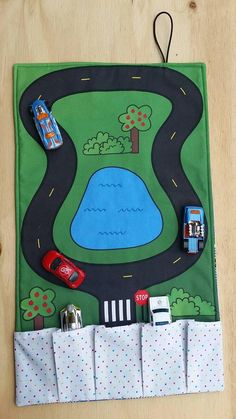 Designed for portability these matchbox car travel play mats will entertain your child whilst on the go. The mats have a unique road road scene and five pockets in various sizes to hold matchbox, hot wheel or any other small cars that are your childs favourite. The mat folds up into a