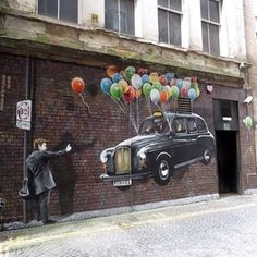 London Taxi  lifted up by Balloons