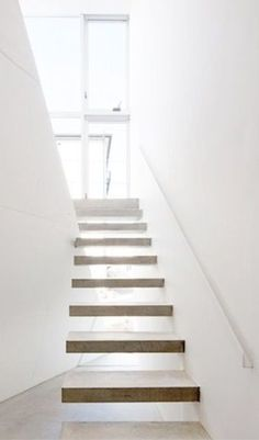 floating light wood stairs