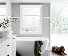 Former Block contestants transform a heritage Queenslander home The Hamptons style bathroom is a family-friendly space where Murphy the mini labradoodle is also welcome. Hampton Style Bathrooms, Grey Bathrooms, White Bathroom, Small Bathroom, Master Bathroom, Bathroom Bin, Family Bathroom, Bathroom Cabinets, Bathroom Faucets