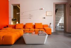 B&B Italia TUFTY TIME Sofa by Patricia Urquiola and Flos 265 Wall Fixture by Paolo Rizzatto.