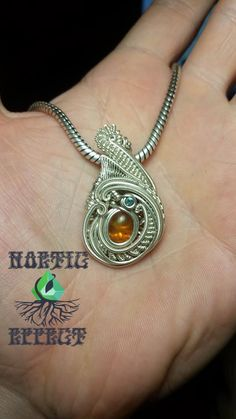 High End sterling silver and mexican fire opal pendant. Find an extensive gallery as well as ready to ship jewelry at www.noeticeffect.com   #wirewrap #jewelry #wirewrapjewelry #oneofakindjewelry #headyart #headywirewrap #gemstones #wirewrapping #wirewraptutorial #highendjewelry #weddingring #silversmithing  #metalwork #designerjewelry #oneofakind #crystals #noeticeffect #gratefuldead #coloradoart #sterlingsilver #gold #rosegold #wirewrappedring #wirewrappedbracelet #headyglass…