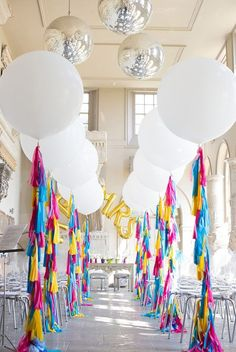 Bright and white wedding with oversized balloons, tassels, and glamour. Love!!