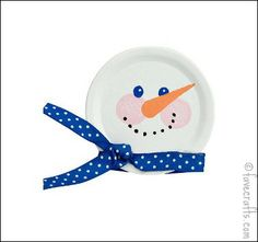 Canning Jar Lid Turned Snowman:   Using some ribbon, paint and a canning jar lid create an adorable snowman decoration.
