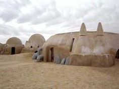 Star Wars fan? Maybe you'd like to visit Luke Skywalkers' underground caves on the Tatooine.  George Lucas filmed those scenes at a traditional Berber home in Matmata, Tunisia. Now the Hotel Sidi Driss, you can rent a room for under $20 a night. More: http://en.wikipedia.org/wiki/Matmata,_Tunisia , goafrica.about.com/od/peopleandculture/ss/Star-Wars-Tours-In-Tunisia.htm http://www.setofdrifters2.com/tozeur.html