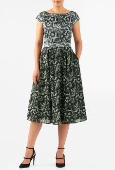 Our graphic floral print polydupioni dress is cinched in with an elasticated self-belt and a wide bow at the back. The princess-seamed bodice and pleated skirt are classically flattering, while pockets and a midi-length hemline offer modern elements.