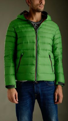 Green ultra light down jacket featuring zip fastening with double puller, long sleeves, two zippered seam pockets, inner pockets, elasticized waistband, Velcro cuff closure, no detachable hood, removable polycarbonate lenses in silicone frame, mesh grate detailing ears and mouth, removable pompom, regular fit, 100% polyamide, padding 100% goose down feather.