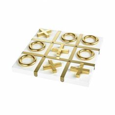 Contemporary White Tic-Tac-Toe Game with Gold Accents  White Finished Wood Tic-Tac-Toe Board with Gold Tone Metal Pieces Vanquish Decorative Tic Tac Toe Game Collection: Vanquish Finish: Gold Material: Wood, Metal Overall Dimensions in Inches: Height: 0.8 Width: 13.2 Length: 13.2