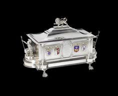 A SUPERB MOTORING AND AVIATION THEMED STERLING SILVER PRESENTATION CASKET BY EDWARD DIMES OF LONDON, 1916, PRESENTED TO JAMES ARMSTRONG WILDING,