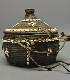 Africa | Old lidded basket made from woven fiber, cowrie shells and leather straps
