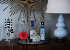 um those vintage {looking} drink mixing tools are AWESOME.  and so is the alcohol tray with classic crystal bottles.
