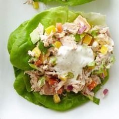 Crunchy Confetti Tuna Salad | The herb-infused dressing in this healthy tuna salad recipe calls for equal parts Greek yogurt and low-fat mayo to keep it light. Lots of fresh veggies, including bell pepper, carrot, radishes and celery, also give boosts of flavor, color and nutrients.