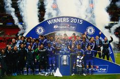 Captain John Terry of Chelsea poses with team mates and the trophy during the Capital One Cup Final match between Chelsea and Tottenham Hotspur at Wembley Stadium on March 1, 2015 in London, England.
