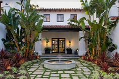 The gorgeous little fountain and lush greenery make this private garden a Spanish Revival dream.