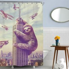 You know you want a Slothzilla staring at you while you pee ($39.99)! | 17 Shower Curtains That Might Actually Make You Want To Shower
