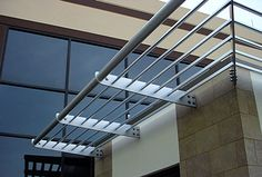 Aluminum sunshades on an office building enterance Aluminum Awnings, Metal Awning, Metal Pergola, Window Awnings, Radiant Heat, Minimalist Living, Windows And Doors, Modern Contemporary, Interior Architecture