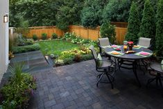 Stylish patio in Minnesota. This paver patio and small garden make a great outdoor entertaining space. Houzz readers saved this photo for its small-space inspiration and lush landscaping ideas.