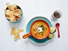 Creamy Avocado Chipolte Sweet Potato Soup With Avocado, Sweet Potatoes, Chipotles In Adobo, Garlic, Cumin, Salt, White Pepper, Raw Honey, Lime, Water, Cilantro, Tortilla Chips, Sour Cream, Avocado, Baby Spinach