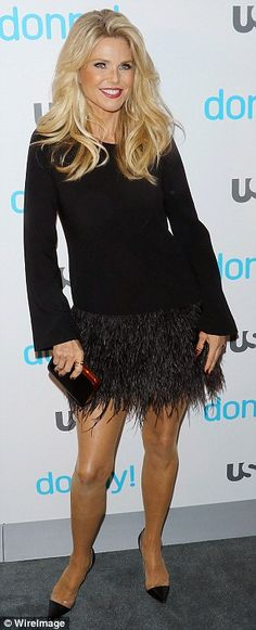 Fun in fringe: The model showed off her fabulous figure in a feathered mini dress
