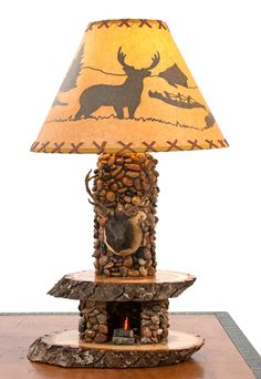 Rustic Cabin Lighting by Woodland Creek Furniture. Available with Bear, Buck, Fish or Elk Mount.