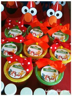 Love this for the kids table  Elmo/Abby take and toss sippy cup favors