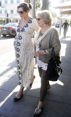 Comfortable clothing: The model and movie star covered her baby bump in a loose-flowing cr...