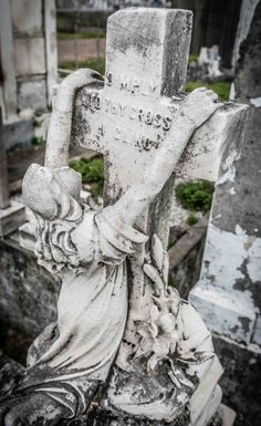 Marker- Weeper Hangin from a Cross at the Lafayette Cemetery #2 New Orleans photo by Gerard Plauche. http://www.thefuneralsource.org/cemla.html