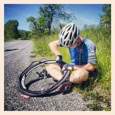 FitOldDog fixing a flat. Never did work out why it went down. Photo by Duncan Morgan.