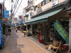Picture of Yanaka Ginza neighborhood, Tokyo City, Japan,  2007 by Parent (Tokyo Shopping District, Market, Middle Class Residential Neighborhood). The Yanaka Ginza street. A charming old shopping district. A soba restaurant, a bookstore, liquor stores, clothing - anything can be found. Not expensive generally, and some good quality goods can be found. (486.93 KB) Photo viewed 540 times