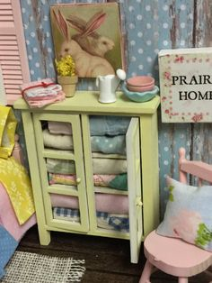A personal favorite from my Etsy shop https://www.etsy.com/listing/265194903/yellow-miniature-dollhouse-quilt-hutch