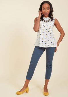 <p>Let the cool confidence you feel in this white blouse inspire you to send your portfolio out to your network. With yellow and black birds, loop-enclosed buttons, and pintucks at the bodice, this top is lighthearted-meets-professional - just like your work, and your wonderful way of living!</p>