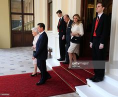 Queen Elizabeth II (front L) and Prince Philip, Duke of Edinburgh descend the Grand Entrance before bidding farewell to Mexican President Enrique Pena Nieto (front R) and Mexico's First Lady Angelica Rivera at Buckingham Palace on March 5, 2015 in London, England. Today is the final day of the Mexican President's visit to the UK and he will travel to Aberdeen to meet senior representatives of the gas and oil industry.  (Photo by Jonathan Brady - WPA Pool/Getty Images)