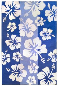 Create a fun beachy look in any room with this Hibiscus Striped Area Rug, covered in large off-white hibiscus floral images with cool stripes of blues.