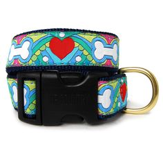 Hearts and Bones Dog Collar. Add some color to your pup's wardrobe! This collar features bones, hearts and a colorful design. Made with quality, stain and fray resistant ribbon sewn onto durable, high-tensile strength nylon webbing. Hardware is solid brass, snap hooks are steel with a brass finish, and quick release buckles are Coast Guard approved for high weight hold. Machine wash, air dry. Don't forget the matching leash!     Sizing:  XS(N): 6-12 in. L x 5/8 in. W  S(N): 9-15 in. L x ...