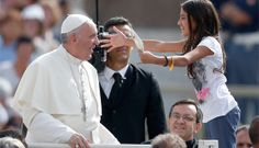 A girl holds a letter as she greets Pope Francis as he arrives to lead his general audience in St. Peter's Square at the Vatican Sept. 11. Such joy on both faces!!
