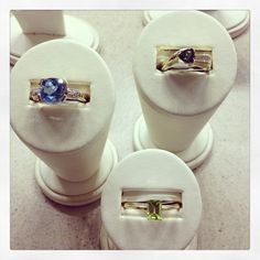 Yellow gold cushion cut Swiss blue topaz and diamond ring; yellow gold trillion mystic topaz and diamond channel ring; yellow gold emerald cut peridot ring.
