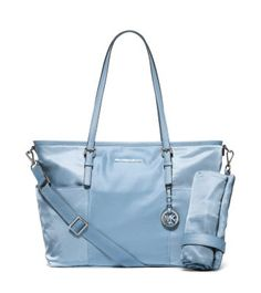 A baby staple goes high style. Taking design cues from our signature Jet Set tote, this diaper bag boasts all of the essentials—an adjustable shoulder strap, changing mat, interior and exterior pockets and a secure zip closure. Let this go-everywhere piece instill your everyday with a deserving dose of glamour.
