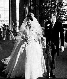 Wedding gown nr 4: Princess Margaret and Anthony Armstrong-Jones, Westminster Abbey. 6 May, 1960. Margaret turned to Norman Hartnell for her wedding gown design. The bodice featured long sleeves and a v-neck, using 30 yards of sheer silk. The slim fit top ballooned into a large skirt. The skirt, in 12 panels, used another 40 yards of fabric plus an 8 layer stiff tulle petticoat underneath to create its shape. It extended into a train behind.