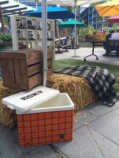 Vintage eskies and crates on straw bales
