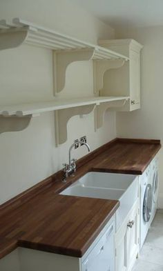 utility room shelving and cupboard run/work tops